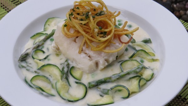 Milk Poached Cod over Creamy Dill Spring Greens topped with a Crispy Garlic Chive Potato Nest